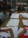 طلاب الصف الثاني \د منهمكين في الرسم
